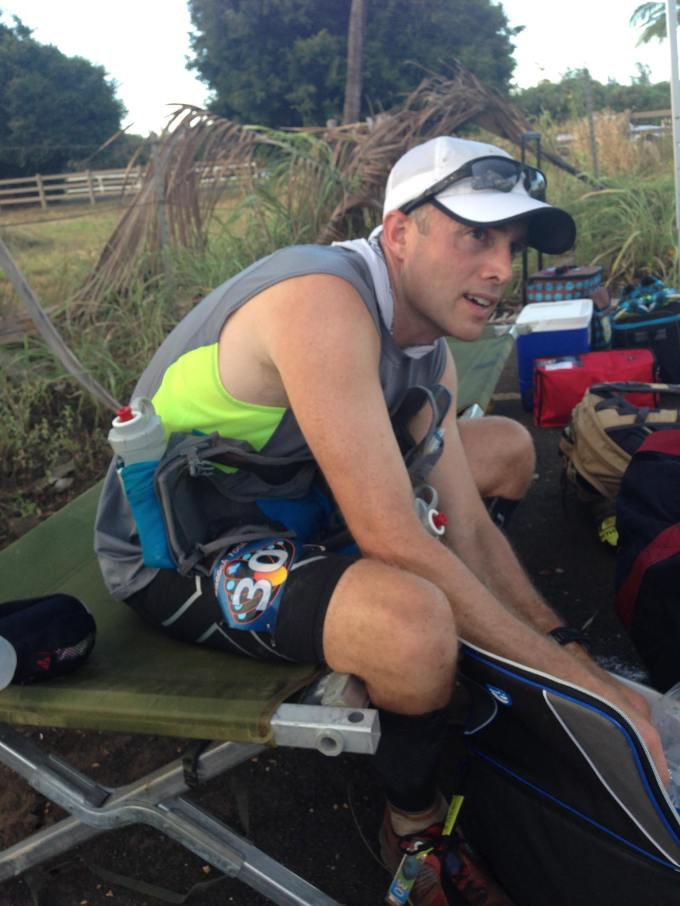 Rifling through my drop bag/ice chest as I take a breather after 52 miles of running. (Photo by Treena Butera)